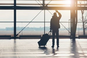 Airport Transfers Gold Coast and Brisbane QLD man waving at airport